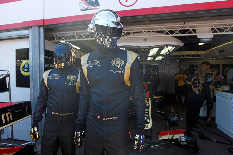 Daft Punk at the Monaco race wearing a custom Lotus F1 outfit